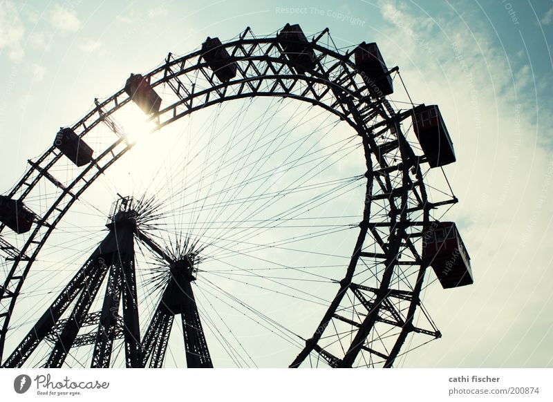 Ferris wheel Tourism Sightseeing City trip Summer Vienna Austria Tourist Attraction Landmark Blue Prater Wheel Sky Clouds Amusement Park Colour photo