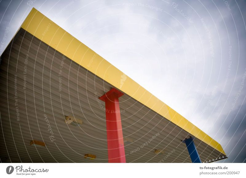 blue yellow red Sky Clouds Bad weather Verden Manmade structures Petrol station Roof Column Steel carrier Steel construction Canopy Lamp Lighting