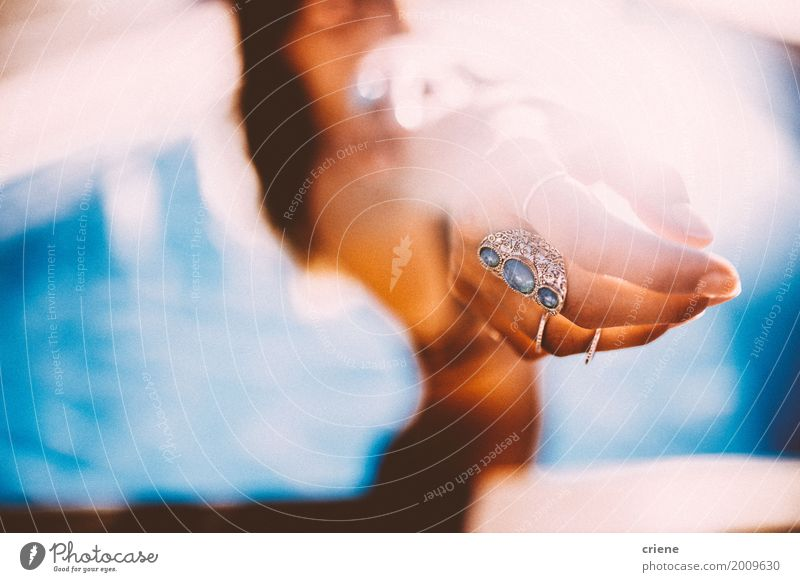 Close-up of womans hand in swimming pool Lifestyle Style Beautiful Swimming pool Vacation & Travel Summer Sun Feminine Young woman Youth (Young adults) Woman