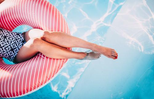 Woman relaxing on inflatable ring in swimming pool Lifestyle Spa Swimming pool Vacation & Travel Summer Feminine Young woman Youth (Young adults) Adults