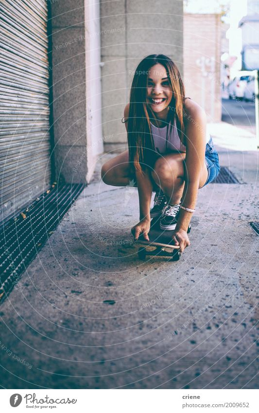 Happy female riding skate board in street Woman Youth (Young adults) Summer Young woman Joy 18 - 30 years Adults Street Lifestyle Funny Sports Feminine Happy Freedom Leisure and hobbies Smiling