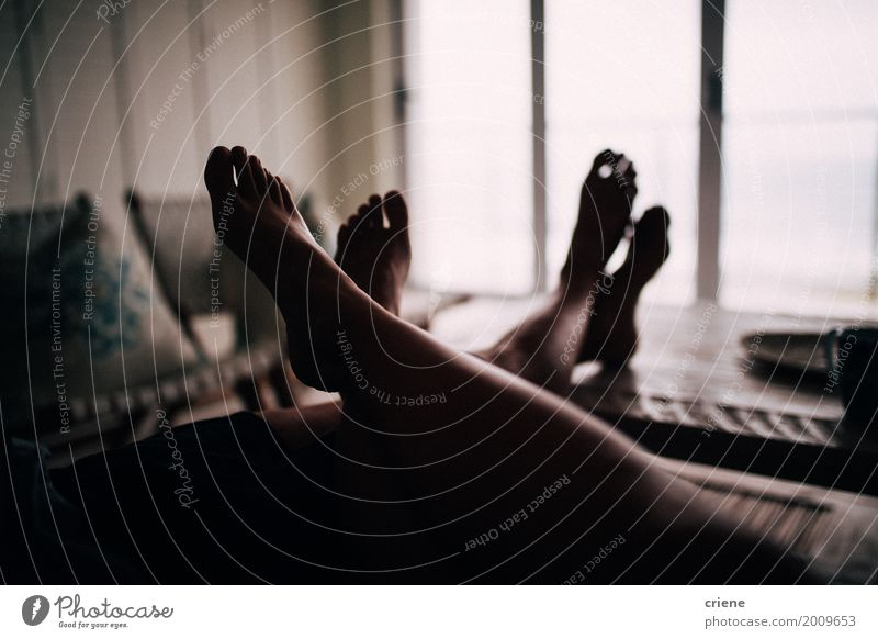 Close-up of feet on table of cute couple Human being Youth (Young adults) Relaxation House (Residential Structure) Adults Lifestyle Legs Couple Feet