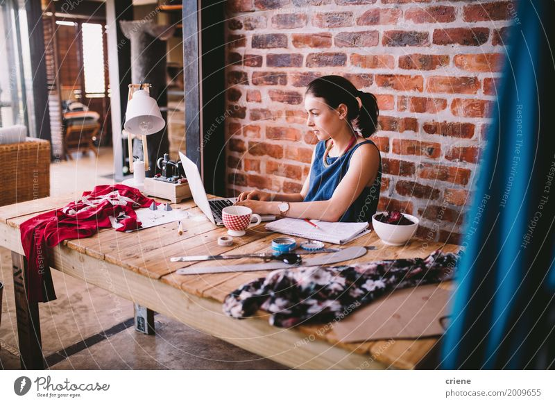 Young busineswoman working on laptop at desk in office Human being Woman Youth (Young adults) Young woman Adults Lifestyle To talk Feminine Business