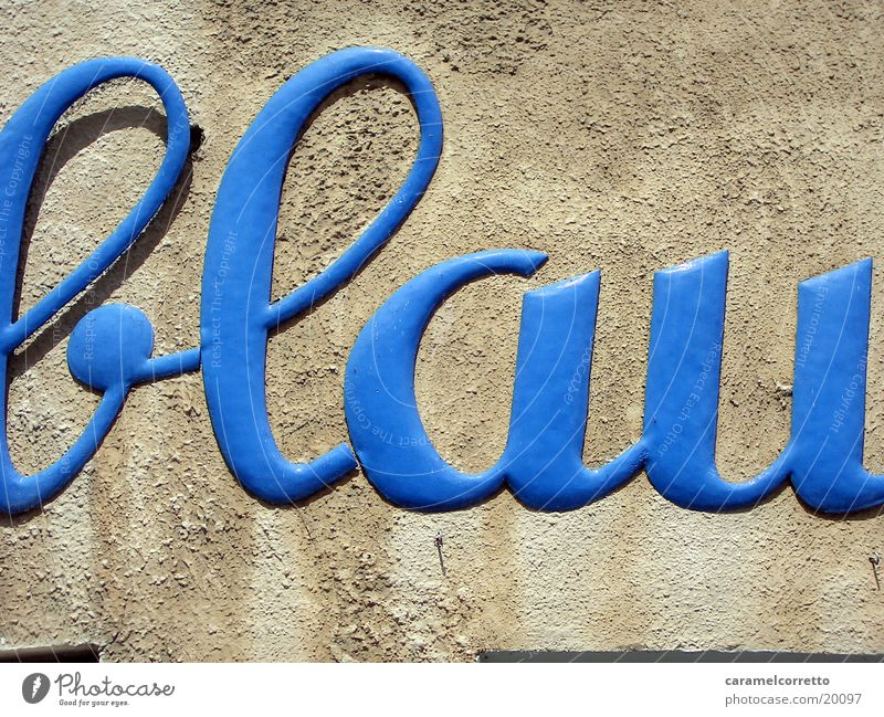 the colour blue Letters (alphabet) Wall (building) Typography Word Things Blue Characters cursive