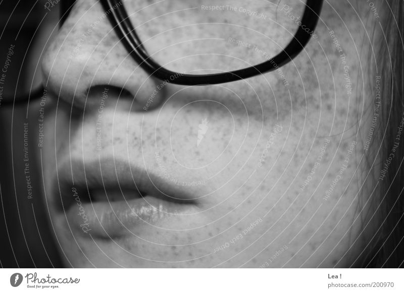 spectacle wearers Feminine Face Freckles 1 Human being Eyeglasses Think Calm Education Person wearing glasses Lips Nose Mouth Black & white photo Interior shot