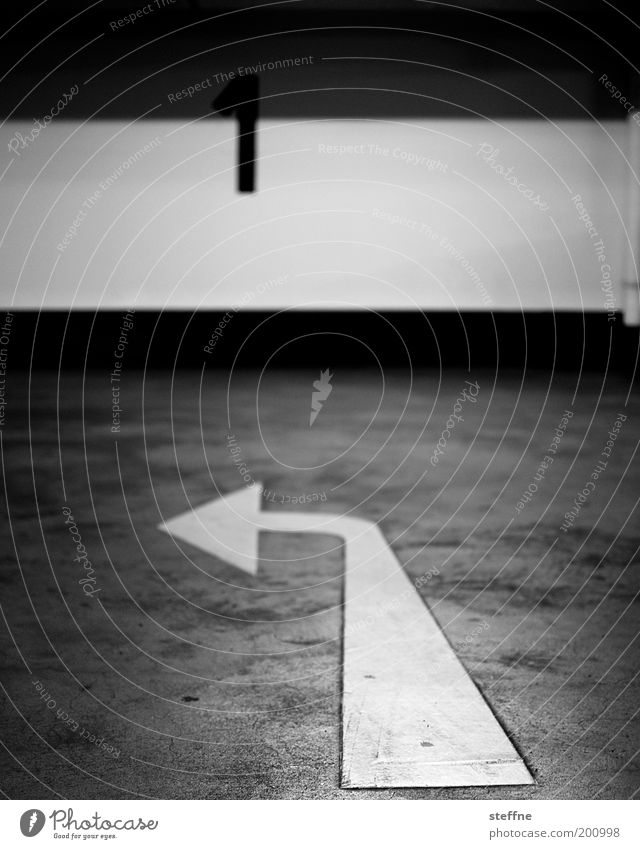NUMBER 1 Transport Street Movement Arrow Parking garage Concrete Direction Turn off Black & white photo Interior shot Left Trend-setting
