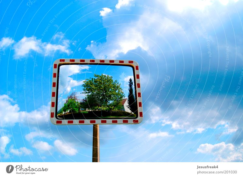 mirror image Nature Sky Clouds Weather Beautiful weather Transport Road traffic Street Metal Signs and labeling Discover Blue Contentment Surrealism Street sign