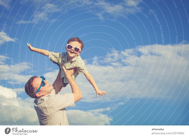 Father and son playing in the park at the day time. Child Nature Vacation & Travel Man Summer Sun Relaxation Joy Beach Adults Life Lifestyle Love Emotions Boy (child) Family & Relations