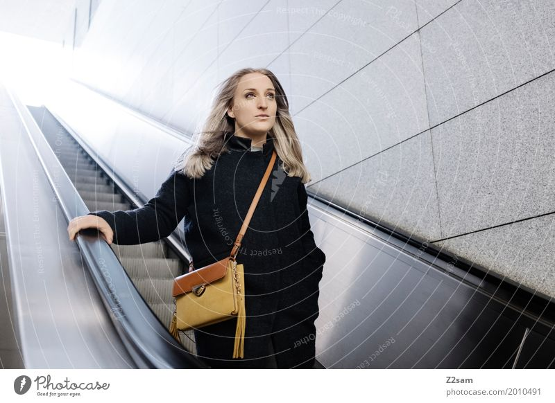 Woman on escalator Lifestyle Elegant Style Adults 18 - 30 years Youth (Young adults) Town Fashion Coat Bag Blonde Long-haired Think Driving smile Dream luck