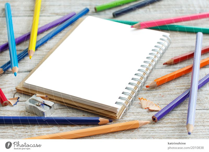 Drawing-pad and color pencils on a wooden table Design School Group Wood Bright Blue Yellow Green Pink Red White Colour Creativity colorful drawing education