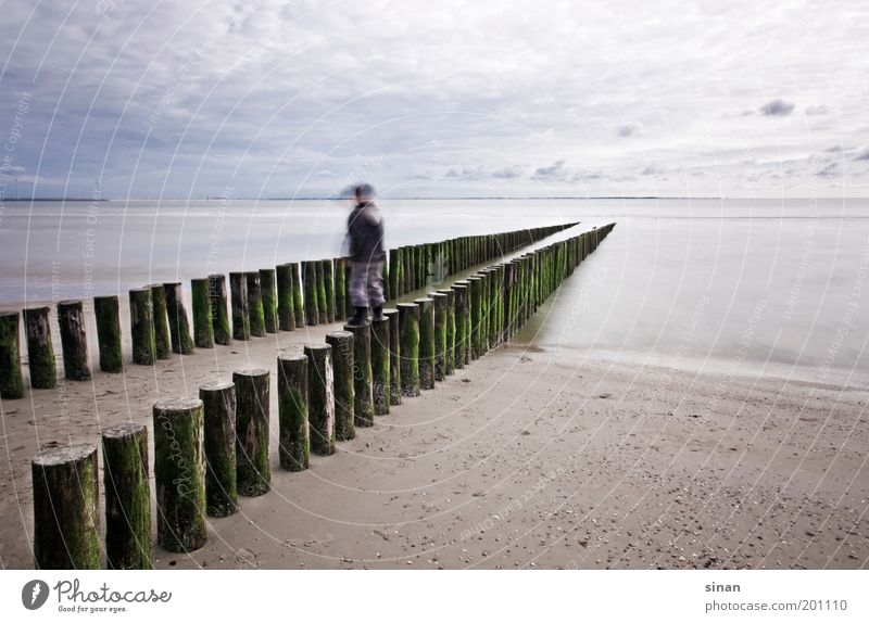 Child Nature Water Sky Ocean Blue Beach Calm Clouds Far-off places Cold Boy (child) Wood Gray Coast Weather