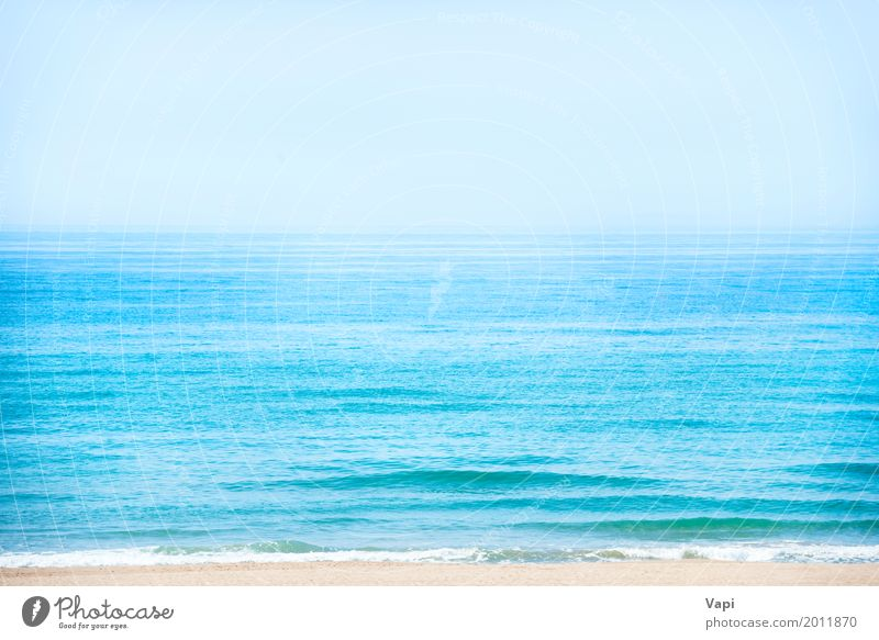 Beach with calm blue sea and clear sky Sky Nature Vacation & Travel Blue Summer Colour Water White Sun Landscape Ocean Clouds Far-off places Beach Environment Yellow