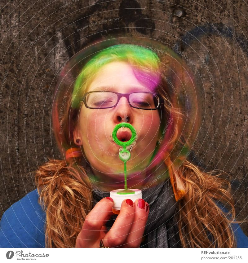 Young woman with a big soap bubble Human being Feminine Youth (Young adults) Head 1 18 - 30 years Adults Playing Happiness Funny Soap bubble Blow Childish