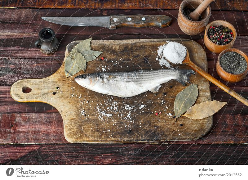 Fresh smelt fish with salt and pepper White Black Eating Natural Wood Food Brown Above Metal Nutrition Table Herbs and spices Kitchen Bowl Knives
