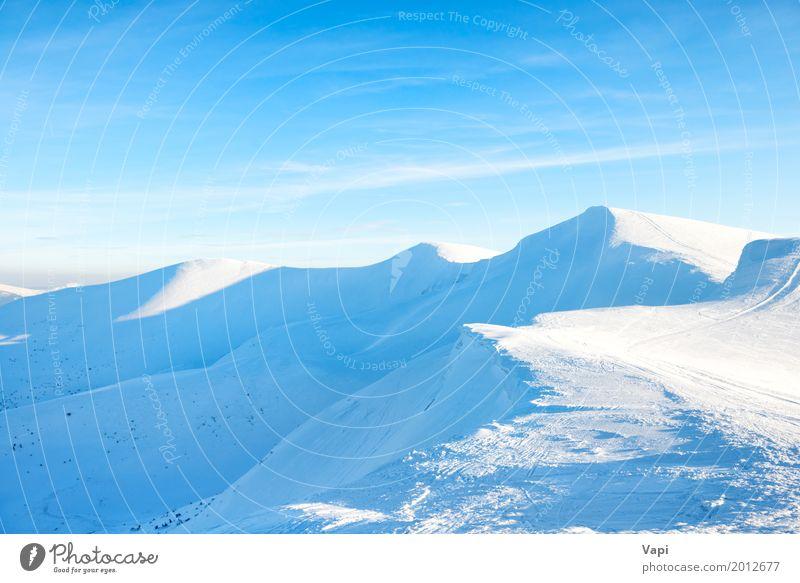 Beautiful winter landscape with snow mountains Sky Nature Vacation & Travel Blue White Sun Landscape Clouds Far-off places Winter Mountain Snow Sports Tourism Rock Vantage point