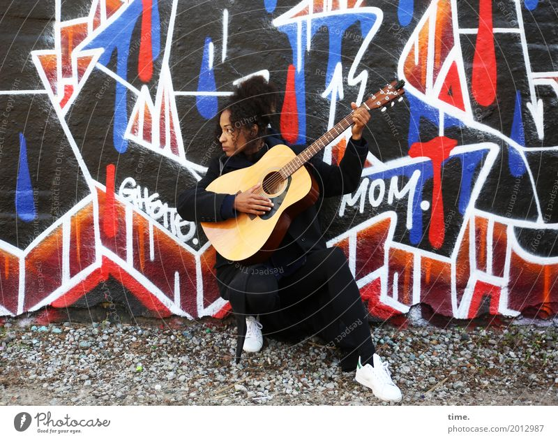 Music Ghetto Mom Feminine Woman Adults 1 Human being Artist Concert Musician Guitar Wall (barrier) Wall (building) Lanes & trails Coat Sneakers
