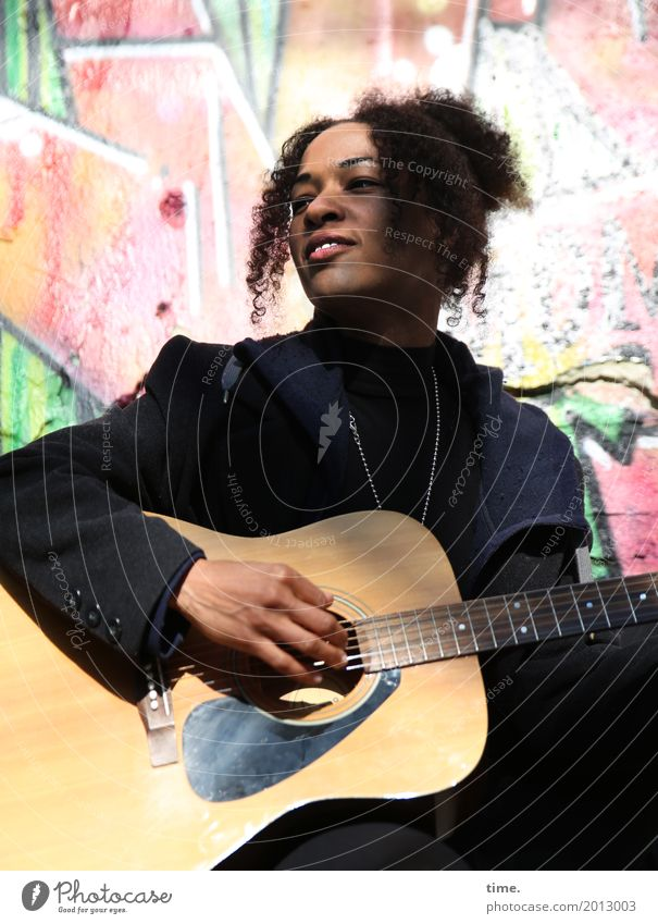 Music | Ghetto Sounds (III) Feminine Woman Adults 1 Human being Singer Musician Guitar Coat Jewellery Hair and hairstyles Brunette Curl Afro Graffiti Observe