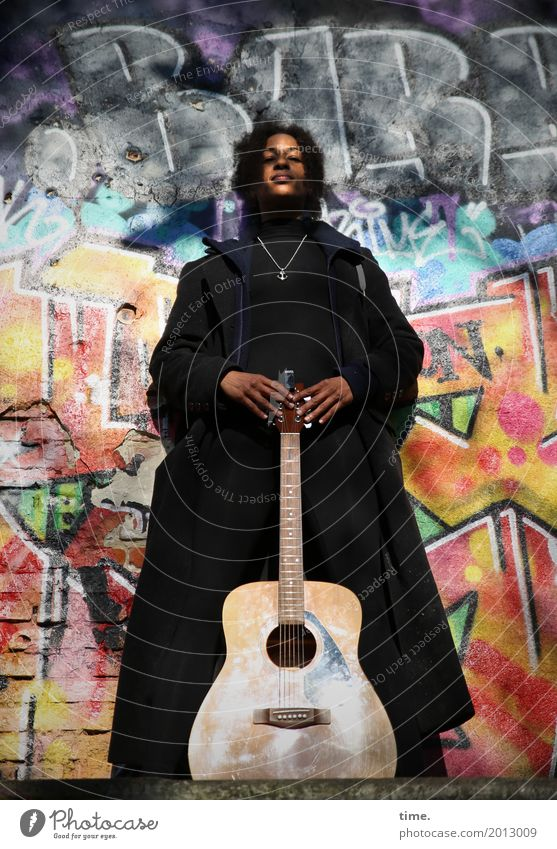 Music Ghetto Priestess Feminine Woman Adults 1 Human being Art Musician Guitar Wall (barrier) Wall (building) Coat Hair and hairstyles Black-haired Long-haired
