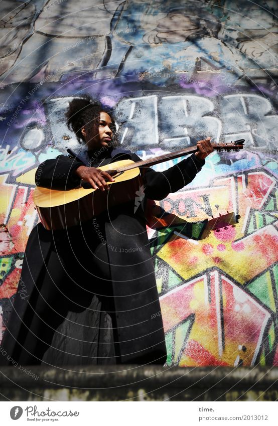 Human being Woman Beautiful Adults Life Graffiti Feminine Playing Hair and hairstyles Stand Passion Watchfulness Long-haired Black-haired Guitar Coat