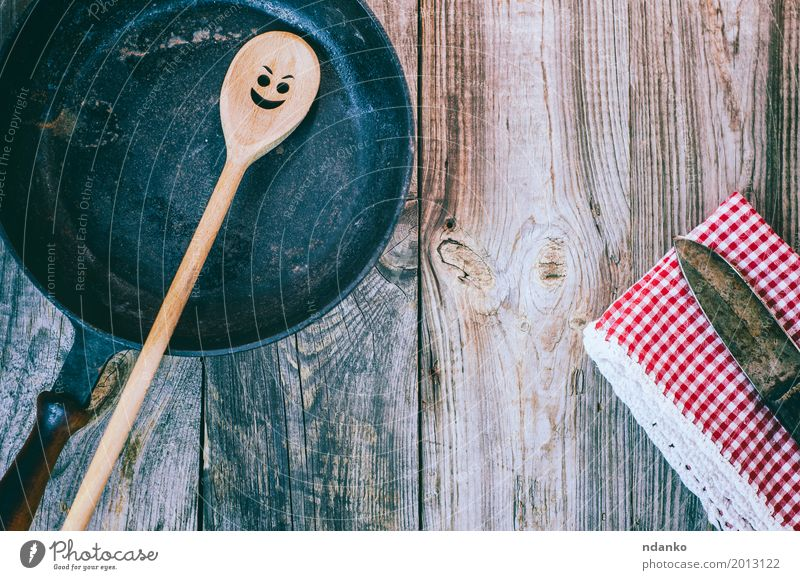 Vintage black frying pan with a wooden spoon Crockery Pan Spoon Table Kitchen Restaurant Cloth Wood Metal Old Above Clean Red Black Emotions tableware
