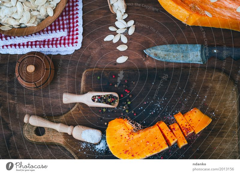 piece of fresh pumpkin with salt and pepper Food Vegetable Herbs and spices Nutrition Knives Spoon Wood Eating Fresh Above Brown Orange White paprika knife cook