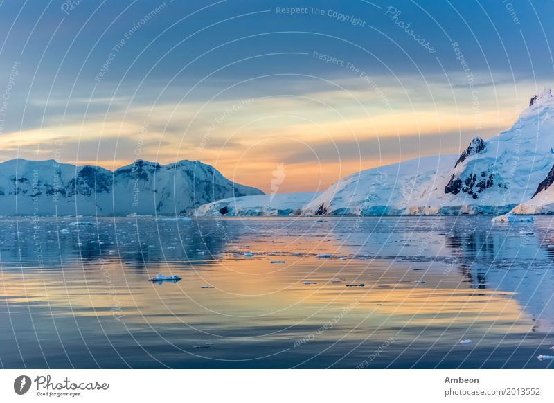 Idyllic lagoon with mountain, Lemaire Strait, Antarctica Sky Nature Vacation & Travel Water Landscape Sun Ocean Clouds Winter Mountain Environment Coast Snow