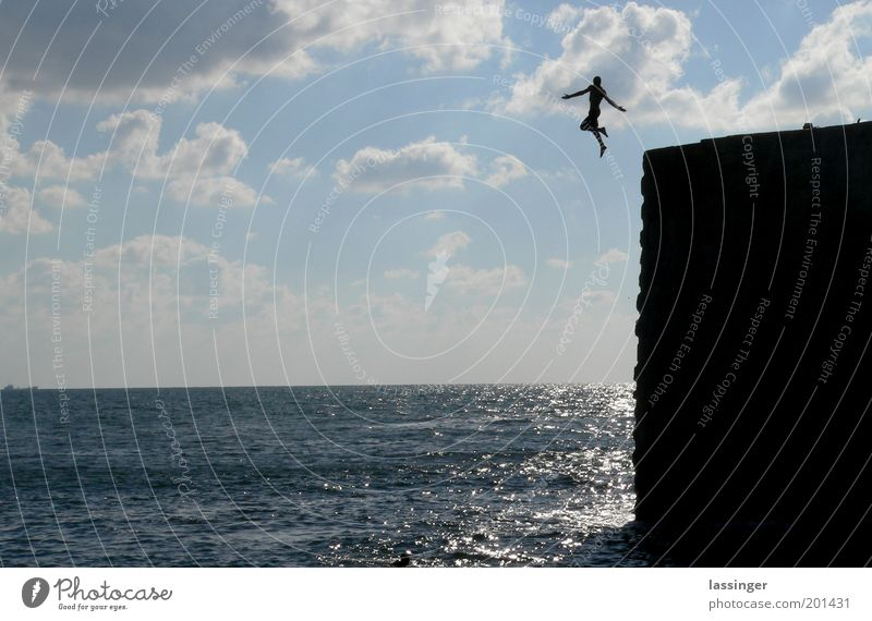 Sky Nature Water Ocean Clouds Environment Landscape Freedom Jump Rock Swimming & Bathing Adventure Joie de vivre (Vitality) Refreshment Human being Height