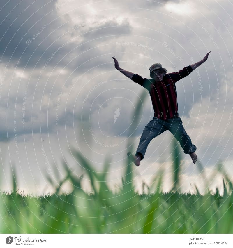 Human being Sky Nature Youth (Young adults) Blue Green Clouds Adults Environment Playing Grass Happy Jump Body Leisure and hobbies Flying