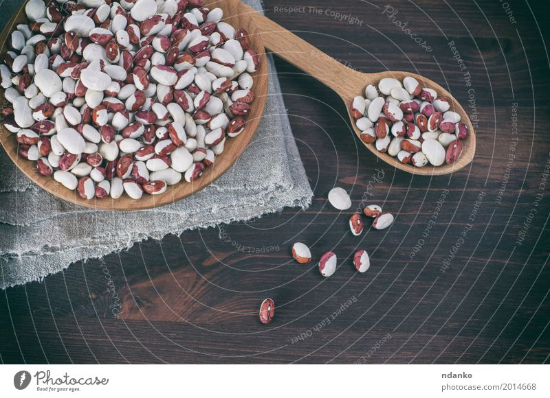 Red white beans in a wooden bowl and spoon Vegetable Fruit Nutrition Eating Vegetarian diet Diet Bowl Spoon Wood Fresh Brown White grain Vegan diet agriculture