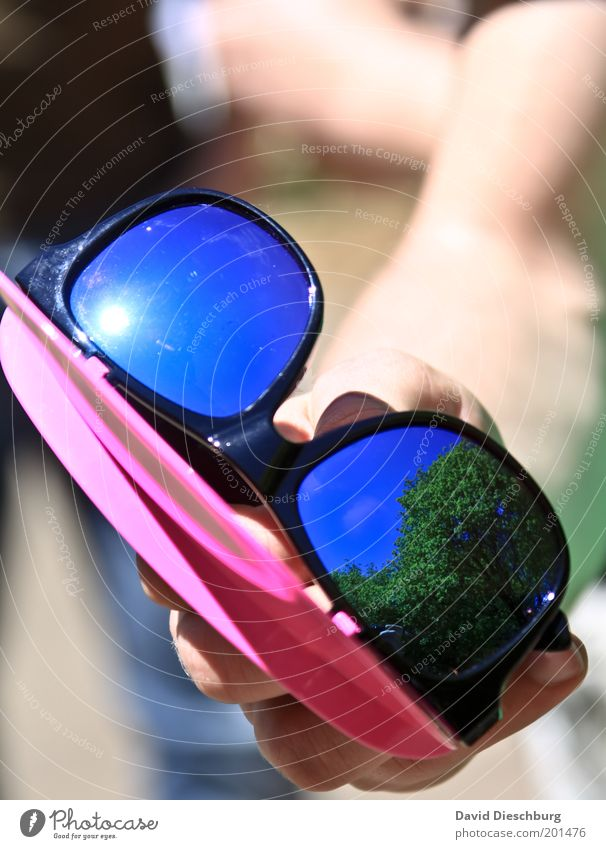 Human being Hand Summer Warmth Beautiful weather To hold on Plastic Sunglasses Eyeglasses Mirror image Weather protection UV radiation Seasons Macro (Extreme close-up) Extravagant