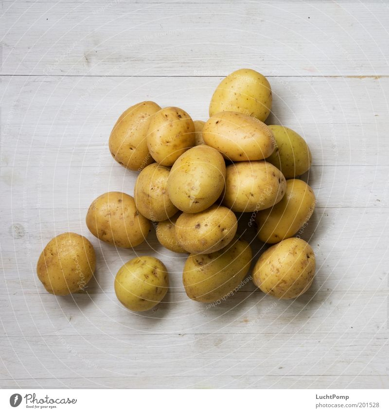 Today we have dumplings Nutrition Healthy Eating Potatoes Heap Many Harvest Delicious Wooden board Wood grain Wooden table Brown Vegetable Appetite Colour photo