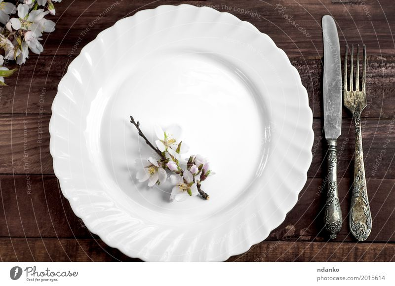 White dish with iron cutlery Lunch Dinner Plate Cutlery Knives Fork Table Kitchen Restaurant Flower Places Wood Metal Steel Old Above Retro Brown knife Dish