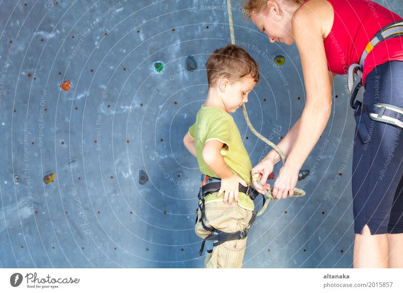 little girl climbing a rock wall Human being Child Vacation & Travel Man Joy Adults Sports Boy (child) Family & Relations Playing Rock Friendship