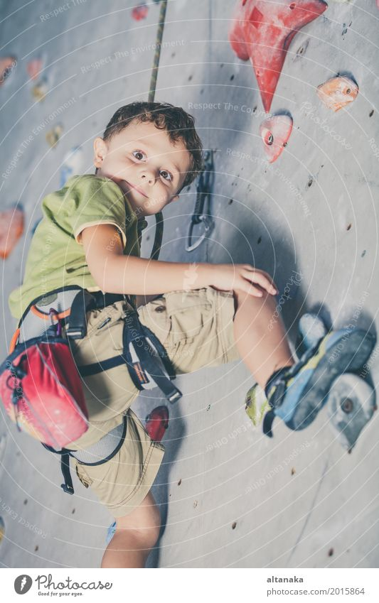 little boy climbing a rock wall Human being Child Vacation & Travel Man Hand Joy Adults Sports Boy (child) Playing Small Rock Leisure and hobbies Park Action