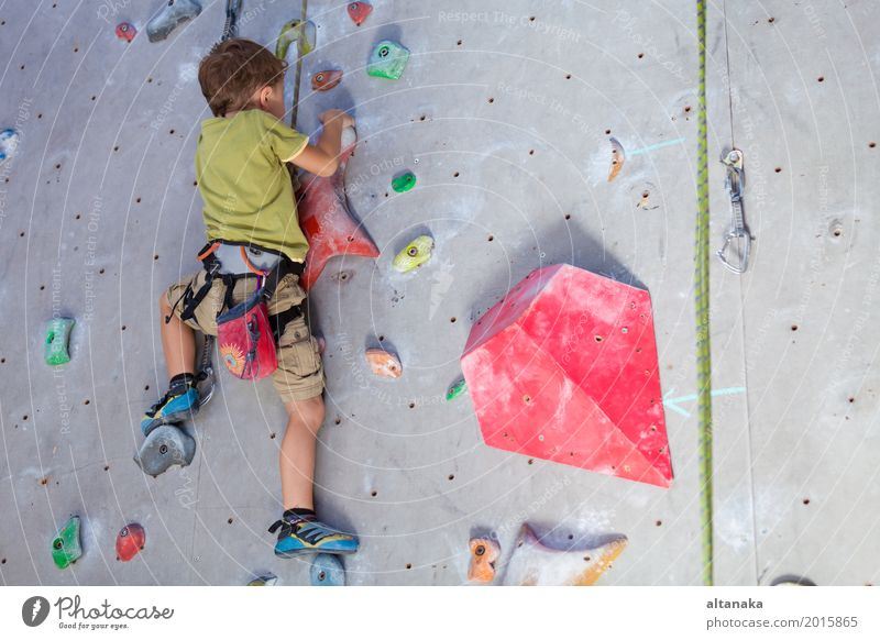 little boy climbing a rock wall Joy Leisure and hobbies Playing Vacation & Travel Adventure Entertainment Sports Climbing Mountaineering Child Rope Human being