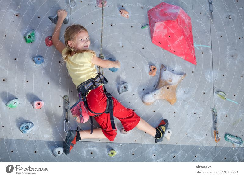 little girl climbing a rock wall Joy Leisure and hobbies Playing Vacation & Travel Adventure Entertainment Sports Climbing Mountaineering Child Rope Human being