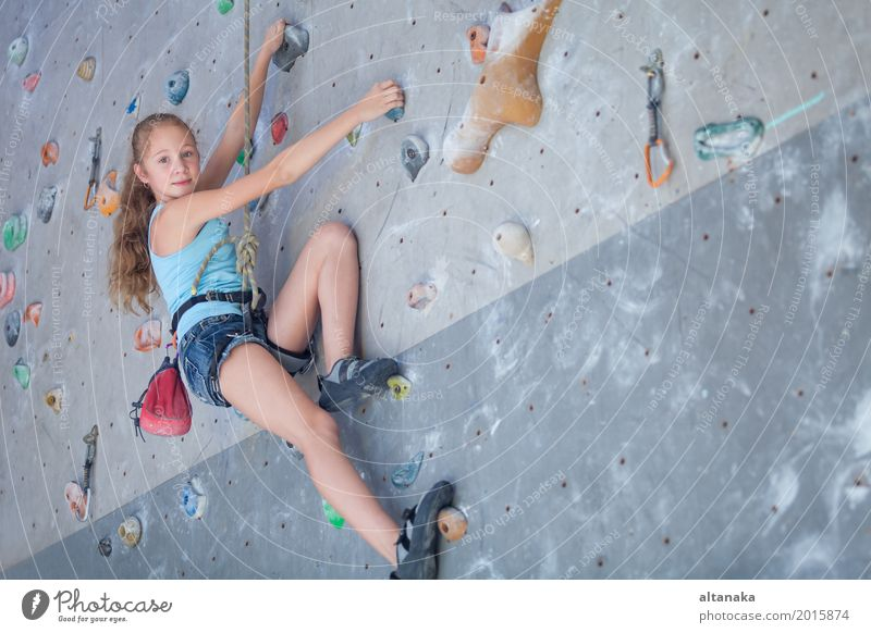 teenager climbing a rock wall Joy Leisure and hobbies Playing Vacation & Travel Adventure Entertainment Sports Climbing Mountaineering Child Rope Human being