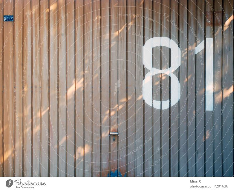 8 1 Door Sign Characters Large House number Garage Garage door Gate 81 Colour photo Subdued colour Exterior shot Deserted Copy Space left Copy Space top