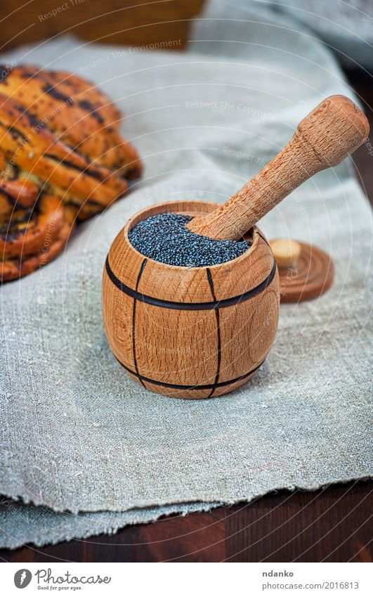 poppy seed in wooden containers Food Roll Dessert Herbs and spices Nutrition Eating Bowl Table Wood Fresh Natural Brown Gray Black Heap grain agriculture rolls