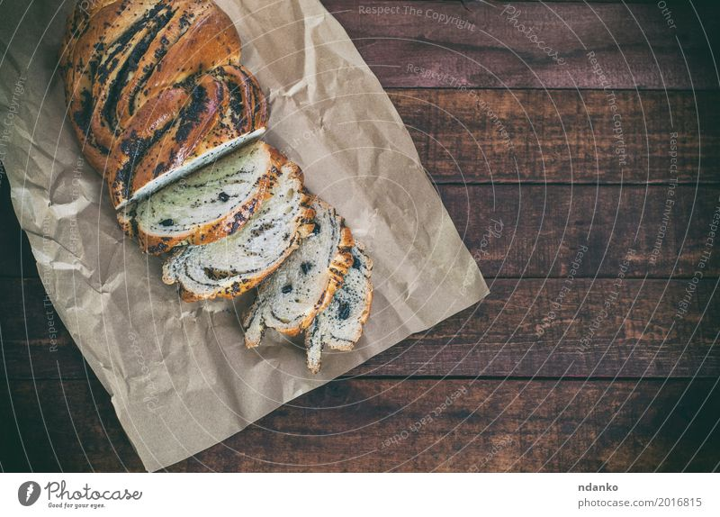 Bun with poppy seeds on kraft paper Black Wood Brown Above Nutrition Fresh Table Paper Delicious Breakfast Poppy Dessert Bread Baked goods Dinner Meal