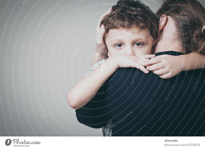 sad son hugging his mother at home. Concept of couple family is in sorrow. Lifestyle Face Child Human being Boy (child) Woman Adults Parents Mother