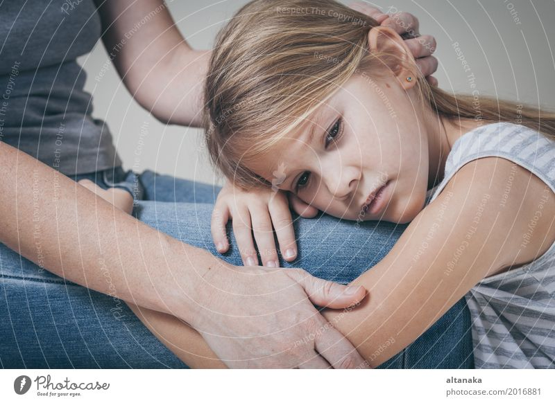 sad daughter hugging his mother at home. Concept of couple family is in sorrow. Lifestyle Face Child Human being Girl Woman Adults Parents Mother