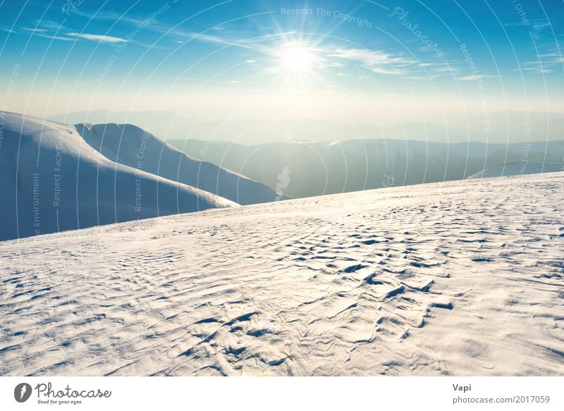 Sunset over winter hills and mountains Sky Nature Vacation & Travel Blue White Sun Landscape Clouds Far-off places Winter Mountain Environment Yellow Meadow Natural Snow