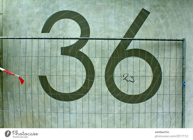 36/23 Digits and numbers House number Wall (barrier) Wall (building) Concrete Construction site Hoarding Fence Metalware Metal construction Closed Border