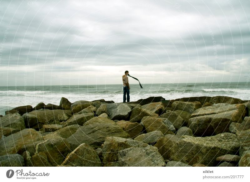 Junge am Strand Human being Ocean Beach Joy Clouds Calm Loneliness Adults Autumn Cold Think Waves Wind Rock Natural
