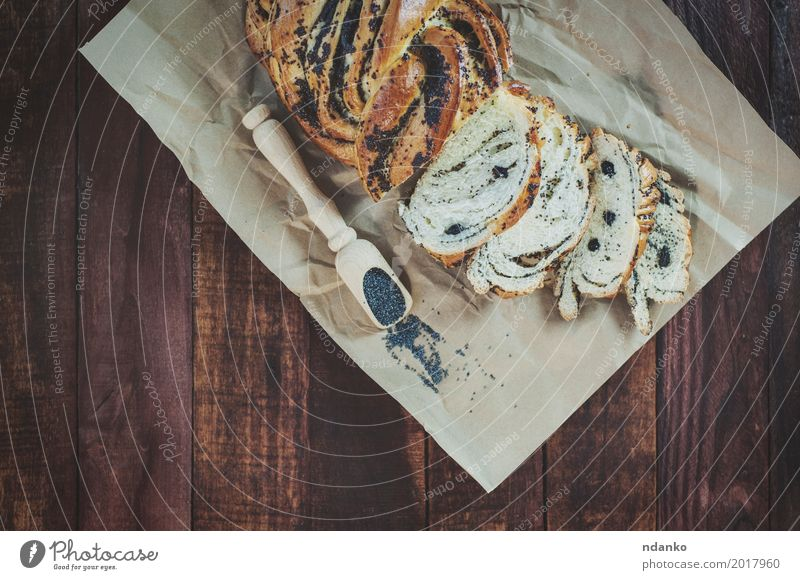 Baked pastry with poppy seeds Food Roll Dessert Herbs and spices Nutrition Spoon Wood Eating Fresh Natural Brown Black rolls pastries Heap sweet Organic healthy
