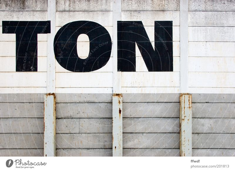 mono Industrial plant Manmade structures Building Wall (barrier) Wall (building) Facade Characters Old Dirty Simple Gloomy Gray Black White Typography Tone Rust
