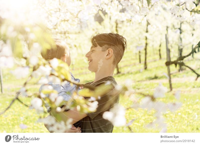 blossoming Joy Child Human being Masculine Baby Boy (child) Family & Relations 2 1 - 3 years Toddler 8 - 13 years Infancy Nature Sun Tree Blossom Garden Park