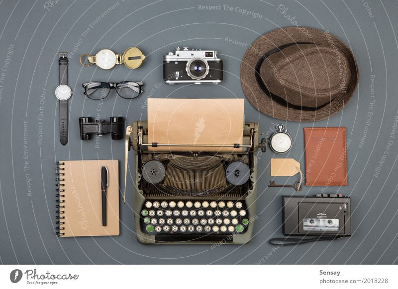 Journalist or private detective workplace Desk Table Workplace Office Newspaper Magazine Book Hat Paper Binoculars Old Observe Write Retro Black Typewriter