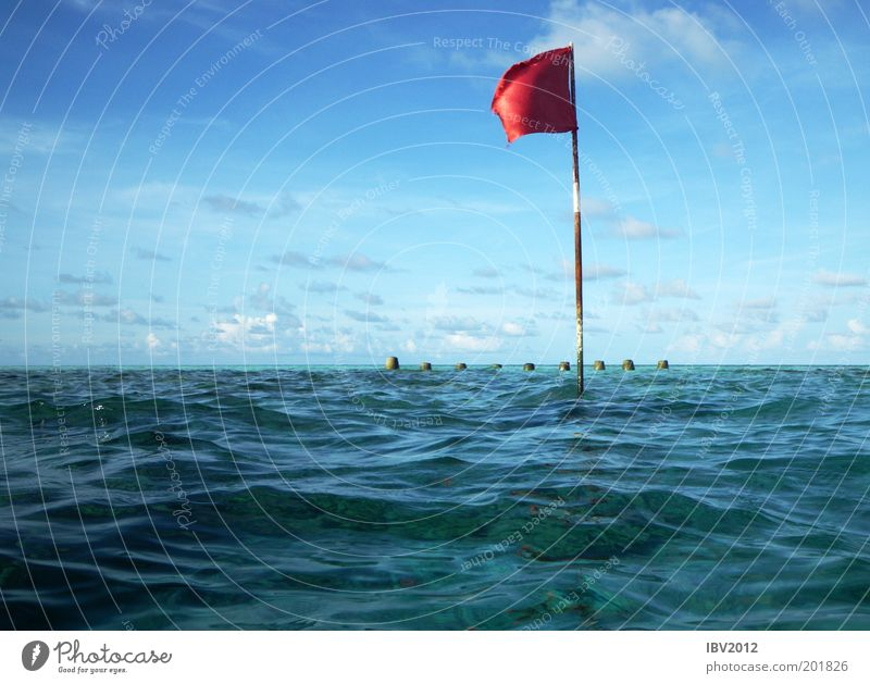 Red flag in paradise Vacation & Travel Tourism Trip Far-off places Freedom Summer Summer vacation Ocean Waves Maldives Environment Nature Water Sky Clouds
